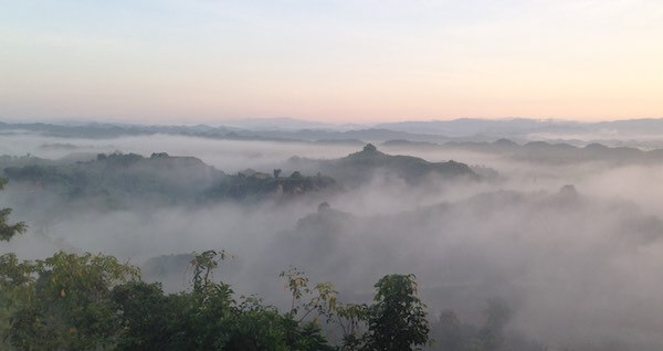 Fog and mist over the hill top pagodas of Mrauk U