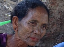 tattooed face woman chin village